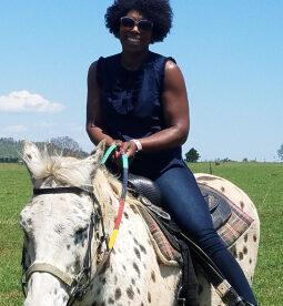 Nicus Employee Riding a Horse