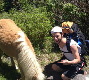 Nicus Employee Hiking with Horse