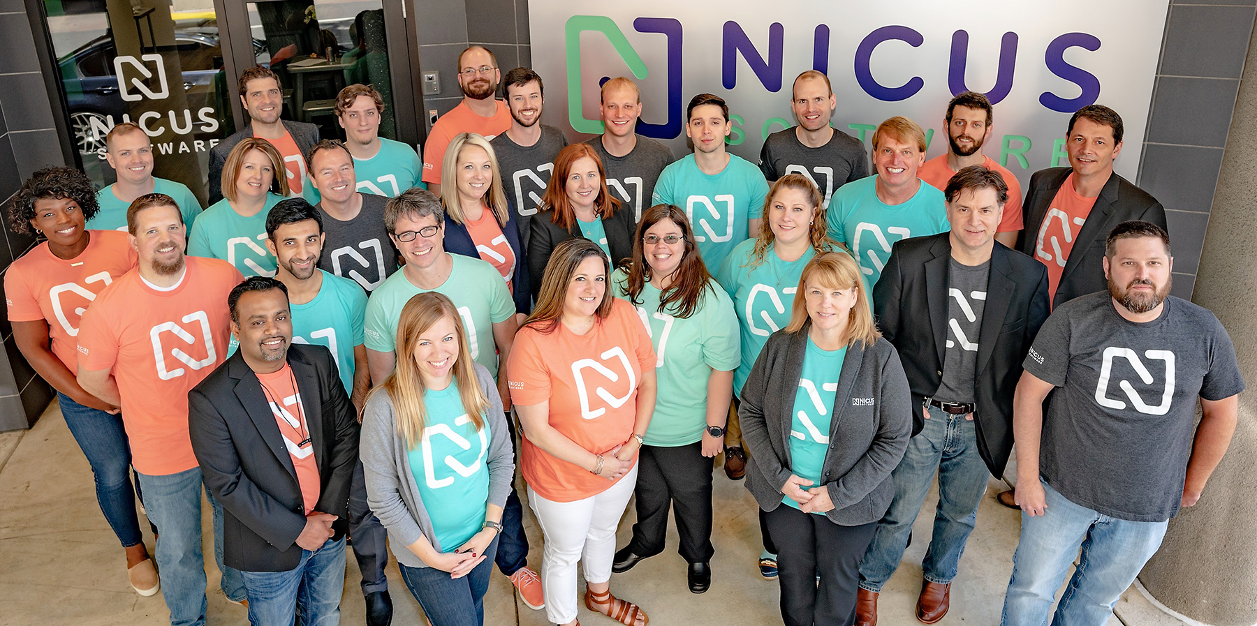 Nicus Employees in front of Headquarters